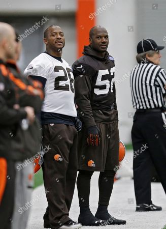 Willis McGahee, D'Qwell Jackson Cleveland Browns running back Willis McGahee (26) and inside linebacker D'Qwell Jackson watch the start of practice at the NFL football team's facility in Berea, Ohio