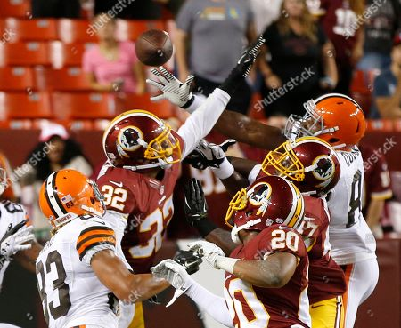 Da'Mon Cromartie-Smith, Richard Crawford, Emmanuel Ogbuehi Washington Redskins defensive back Da'Mon Cromartie-Smith (32) and cornerback Richard Crawford (20) defend as Cleveland Browns tight end Emmanuel Ogbuehi, right, catches a touchdown pass at the end of the second half of an NFL preseason football game, in Landover, Md