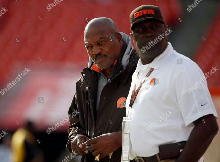 Jim Brown Former Cleveland Brown Jim Brown, left, stands on the field before an NFL preseason football game against the Washington Redskins, in Landover, Md