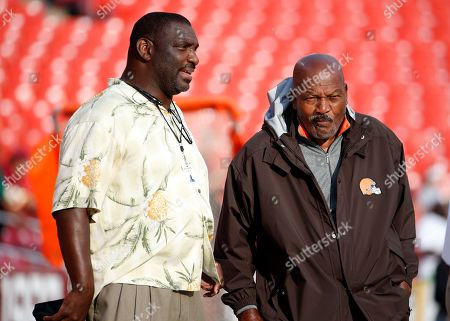 Doug Williams, Jim Brown Former Washington Redskin Doug Williams, left, stands with former Cleveland Brown Jim Brown before an NFL preseason football game, in Landover, Md