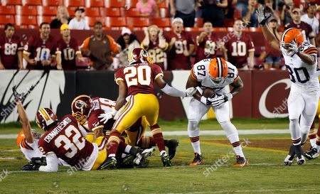 Emmanuel Ogbuehi, Richard Crawford Cleveland Browns tight end Emmanuel Ogbuehi (87) catches a touchdown pass with Washington Redskins cornerback Richard Crawford (20) nearby during the second half of an NFL preseason football game, in Landover, Md