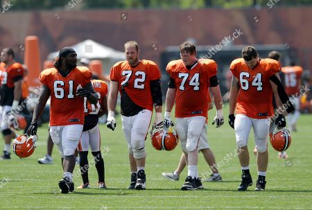 Jeremiah Warren, Mitchell Schwartz, Paul McQuistan, Martin Wallace Cleveland Browns' Jeremiah Warren (61), Mitchell Schwartz (72), Paul McQuistan (74) and Martin Wallace (64) walk off the field after practice at the NFL football team's training camp, in Berea, Ohio