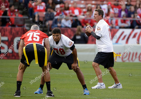 """Dan Marino, Anthony Munoz, Kevin Fagan Miami Dolphins Hall of Famer Dan Marino, right, drops back to throw during the """"Legends of Candlestick"""" flag football game, in San Francisco. Also shown is defensive end Kevin Fagan (75) and offensive tackle Anthony Munoz (78). The game between former San Francisco 49er greats and a team of former NFL stars captained by Hall of Famer Dan Marino is the final one to be played at Candlestick Park. The park, which opened in 1960 and was also the home of the San Francisco Giants baseball team until 1999, is slated for demolition in the next year"""