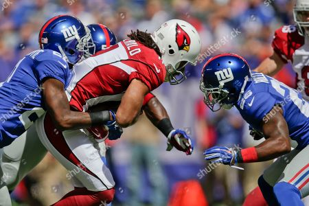 Stock Photo of Antrel Rolle, Jon Beason, Larry Fitzgerald New York Giants cornerback Dominique Rodgers-Cromartie (21), Antrel Rolle (26) and Jon Beason (52) tackle Arizona Cardinals' Larry Fitzgerald (11) during the first half of an NFL football game, in East Rutherford, N.J