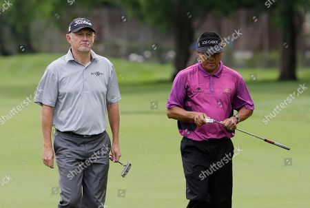 Roger Chapman, Esteban Toledo Roger Chapman, left, and Esteban Toledo walk to the eighth green during the first round of the Encompass Championship golf tournament in Glenview, Ill