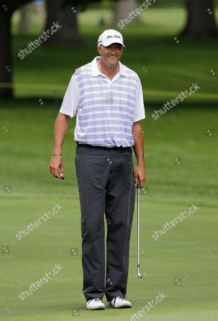 Toni Kukoc Toni Kukoc smiles on the first hole during the first round of the Encompass Championship golf tournament in Glenview, Ill