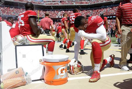Lawrence Okoye San Francisco 49ers defensive end Lawrence Okoye kneels on the sideline before an NFL preseason football game against the San Diego Chargers in Santa Clara, Calif