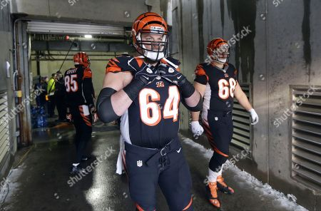 Kyle Cook Cincinnati Bengals center Kyle Cook (64) waits to go onto the field at the start of an NFL wild-card playoff football game against the San Diego Chargers, in Cincinnati