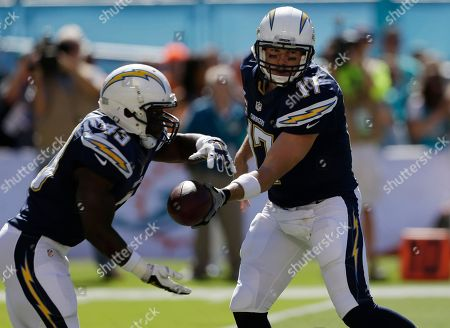 Philip Rivers, Branden Oliver San Diego Chargers quarterback Philip Rivers (17) hands the ball to San Diego Chargers running back Branden Oliver (43) during the first half of an NFL football game against the Miami Dolphins, in Miami Gardens, Fla