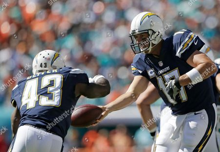 Philip Rivers San Diego Chargers quarterback Philip Rivers (17) hands the ball to running back Branden Oliver (43 ) during the first half of an NFL football game against the Miami Dolphins, in Miami Gardens, Fla