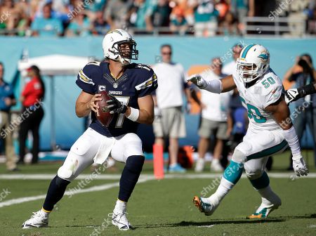 Philip Rivers, Oliver Vernon San Diego Chargers quarterback Philip Rivers (17) looks to pass under pressure from Miami Dolphins defensive end Olivier Vernon (50), during the second half of an NFL football game, in Miami Gardens, Fla
