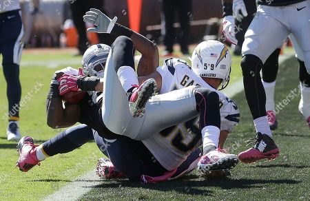 James Jones, Andrew Gachkar Oakland Raiders wide receiver James Jones, top, scores on a 6-yard touchdown reception over San Diego Chargers inside linebacker Andrew Gachkar during the second quarter of an NFL football game in Oakland, Calif