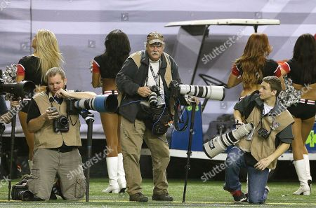 Dave Martin AP Photographer Dave Martin, second from right, works during the first half of an NFL football game between the Carolina Panthers and the Atlanta Falcons, in Atlanta. Martin, a longtime Associated Press photographer based in Montgomery, Ala., died after collapsing on the Georgia Dome field at the Chick-fil-A Bowl on Tuesday, Dec. 31, 2013. Martin was 59