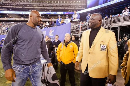 Stock Image of Bradon Jacobs, Lawrence Taylor Former New York Giants Brandon Jacobs and Lawrence Taylor, right, talk before an NFL football game between the New York Giants and the Indianapolis Colts, in East Rutherford, N.J