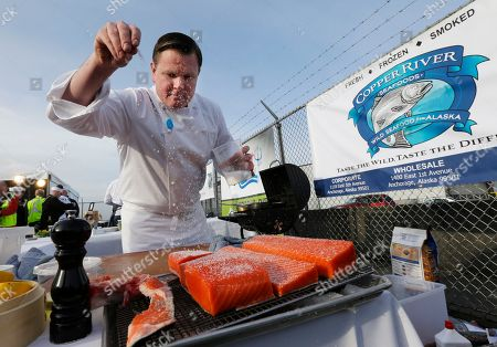 Stock Image of Jason Franey Jason Franey, executive chef at Seattle's Canlis restaurant, sprinkles salt on cuts of Copper River Salmon after the first shipment of the year of the fish arrived, from Cordova, Alaska to the Alaska Airlines Cargo facility in Seatac, Wash. Franey and two other chefs took part in a cook-off competition at the facility as soon as the fish were off the plane. Franey placed third this year