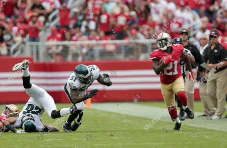 Frank Gore, Emmanuel Acho, Cary Williams San Francisco 49ers running back Frank Gore (21) runs past Philadelphia Eagles cornerback Cary Williams (26) and linebacker Emmanuel Acho (51) during an NFL football game in Santa Clara, Calif