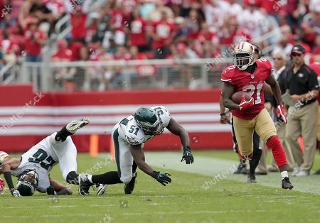 Stock Picture of Frank Gore, Emmanuel Acho, Cary Williams San Francisco 49ers running back Frank Gore (21) runs past Philadelphia Eagles cornerback Cary Williams (26) and linebacker Emmanuel Acho (51) during the second half of an NFL football game in Santa Clara, Calif