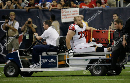 Sam Baker Atlanta Falcons' Sam Baker (72) leaves on a cart after he was injured during the second quarter of an NFL preseason football game against the Houston Texans, in Houston