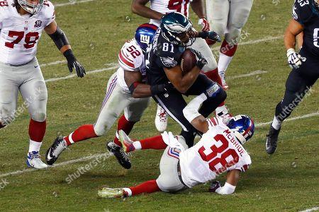 Jordan Matthews, Jon Beason, Trumaine McBride Philadelphia Eagles wide receiver Jordan Matthews (81) is tackled by New York Giants middle linebacker Jon Beason (52) and cornerback Trumaine McBride (38) during the second half of an NFL football game, in Philadelphia