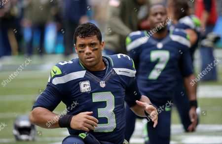 Russell Wilson Seattle Seahawks quarterback Russell Wilson (3) and backup quarterback Tarvaris Jackson stretch before an NFL football game after the game, in Seattle