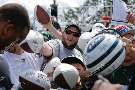 New York Jets fans wait for an autograph from cornerback Dee Milliner after practice during NFL football training camp, in Cortland, N.Y