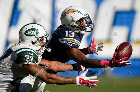 New York Jets cornerback Dee Milliner, left, breaks up a pass intended for San Diego Chargers wide receiver Keenan Allen during the second half of an NFL football game, in San Diego