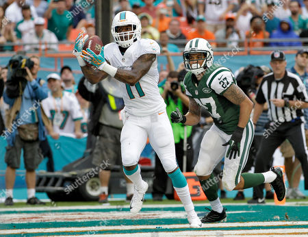 Mike Wallace Miami Dolphins wide receiver Mike Wallace (11) pulls in a 5-yard touchdown pass in front of New York Jets cornerback Dee Milliner (27) during the second quarter of an NFL football game, in Miami Gardens, Fla