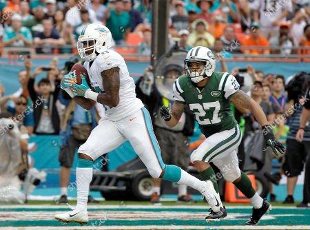 Miami Dolphins wide receiver Mike Wallace (11) beats New York Jets cornerback Dee Milliner (27) to the end zone to score on a five-yard touchdown pass during the second quarter of an NFL football game, in Miami Gardens, Fla