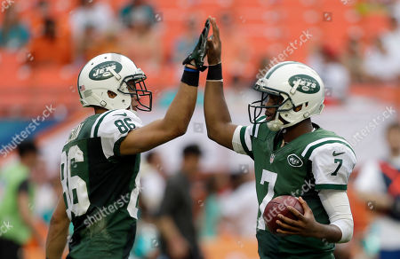 Geno Smith, David Nelson New York Jets quarterback Geno Smith (7) gives a high-five to teammate David Nelson (86) before the last play against the Miami Dolphins in the fourth quarter of a NFL football game in Miami Gardens, Fla., . The Jets won 20-7
