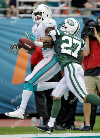 Mike Wallace, Dee Milliner New York Jets cornerback Dee Milliner (27) breaks up a pass intended for Miami Dolphins wide receiver Mike Wallace (11) during the third quarter of an NFL football game, in Miami Gardens, Fla