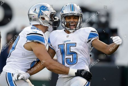 Golden Tate, Joseph Fauria Detroit Lions wide receiver Golden Tate (15) celebrates after scoring on a 28-yard touchdown reception, with tight end Joseph Fauria during the first quarter of an NFL preseason football game against the Oakland Raiders in Oakland, Calif