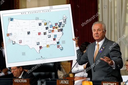Tom LaBonge Los Angeles City Council member Tom LaBonge displays a visual aid showing locations of NFL football teams at City Hall in Los Angeles. Council members voted 14-0 Wednesday for a resolution saying it is in the interests of both the city and the league to bring a team to Los Angeles. Entertainment firm AEG announced, they have requested a six-month extension of the company's agreements with the city of Los Angeles to build a professional football stadium near Staples Center so they can continue negotiations with the NFL to secure a team. AEG's agreements with the city are set to expire on Oct. 18