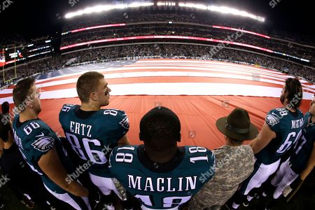 Andrew Gardner, Zach Ertz, Riley Cooper Philadelphia Eagles' Andrew Gardner (66), Zach Ertz (86) and Riley Cooper (14) stand at attention during the national anthem before an NFL football game against the Carolina Panthers, in Philadelphia