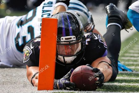 Stock Image of Kyle Juszczyk, Chase Blackburn Baltimore Ravens fullback Kyle Juszczyk lands just short of the goal line after a hit from Carolina Panthers outside linebacker Chase Blackburn (93) during the second half of an NFL football game in Baltimore