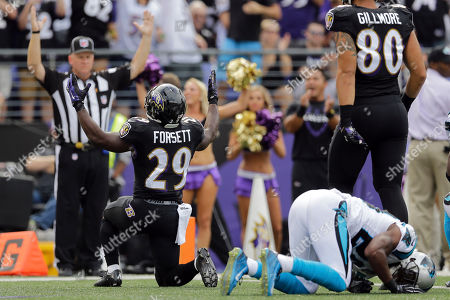 Antoine Cason, Justin Forsett Baltimore Ravens running back Justin Forsett (29) reacts to his touchdown as Carolina Panthers cornerback Antoine Cason (20) lies on the turf during the first half of an NFL football game in Baltimore