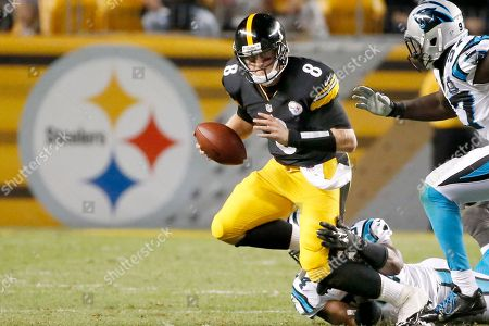 Brendon Kay, Jason Williams, Mario Addison Pittsburgh Steelers quarterback Brendon Kay (8) is hit by Carolina Panthers linebacker Jason Williams (54) as defensive end Mario Addison (97) pursues of a NFL preseason football game on in Pittsburgh