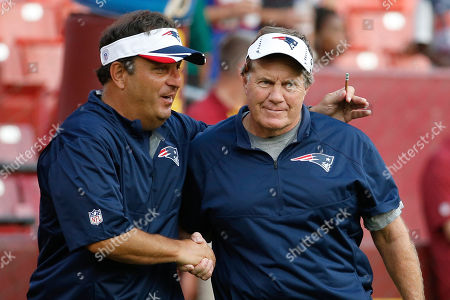 Stock Picture of Michael Lombardi, Bill Belichick New England Patriots assistant coach Michael Lombardi. left, shakes hands with oach Bill Belichick before an NFL football preseason game against the Washington Redskins in Landover, Md