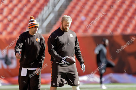 Brian Hoyer, Nick McDonald Cleveland Browns quarterback Brian Hoyer, left, talks with center Nick McDonald before an NFL football game against the Oakland Raiders, in Cleveland