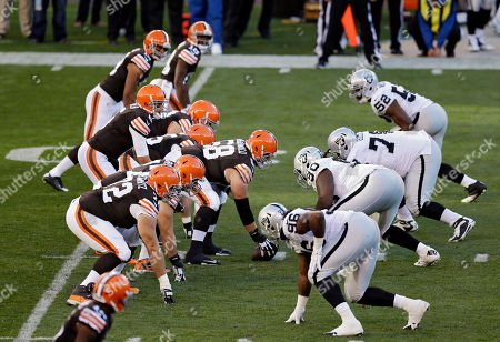 Nick McDonald, Brian Hoyer Cleveland Browns center Nick McDonald (68) prepares to snap the ball to quarterback Brian Hoyer in the second quarter of an NFL football game against the Oakland Raiders, in Cleveland