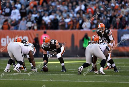 Nick McDonald, Brian Hoyer Cleveland Browns center Nick McDonald (68) prepares to snap the ball to quarterback Brian Hoyer (6) in the first quarter of an NFL football game against the Oakland Raiders, in Cleveland