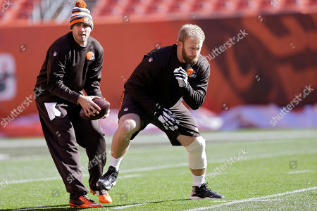 Brian Hoyer, Nick McDonald Cleveland Browns quarterback Brian Hoyer, left, practices snaps with center Nick McDonald before an NFL football game against the Oakland Raiders, in Cleveland