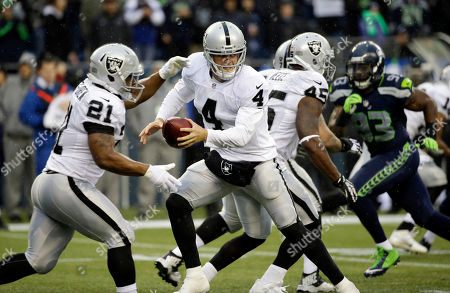 Derek Carr Oakland Raiders quarterback Derek Carr (4) hands off to running back Maurice Jones-Drew (21) in the second half of an NFL football game against the Seattle Seahawks, in Seattle