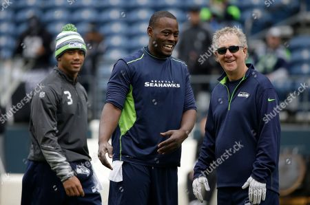 Tarvaris Jackson Seattle Seahawks backup quarterback Tarvaris Jackson, center, talks with Seahawks quarterback coach Carl Smith, right, as they stand with quarterback Russell Wilson, left, before an NFL football game against the Oakland Raiders, in Seattle