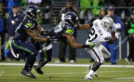 Maurice Jones-Drew Seattle Seahawks outside linebacker Mike Morgan (57) tackles Oakland Raiders running back Maurice Jones-Drew, right, as outside linebacker Bruce Irvin, left, moves in during the second half of an NFL football game, in Seattle