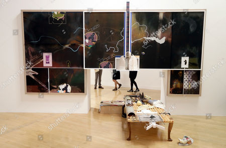 The legs of people are seen as they look towards part of an artwork by Helen Marten, one of the four artists shortlisted for the Turner Prize 2016, as it is displayed at the Tate Britain gallery in London, . The Turner Prize aims to promote public debate around new developments in contemporary British art