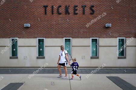 Tyler Moyer, Kristen Moyer Kristen Moyer receives a high-five from her son Tyler, 4, after they traded in his Baltimore Ravens running back Ray Rice jersey, at M&T Bank Stadium in Baltimore. The Ravens offered fans a chance to trade in their Rice jerseys for those of another player after he was cut by the team and suspended indefinitely by the NFL for domestic violence