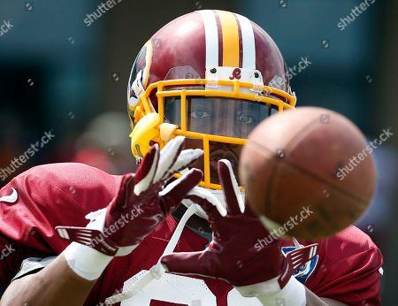 Richard Crawford Washington Redskins cornerback Richard Crawford catches the ball during NFL football training camp, in Richmond, Va