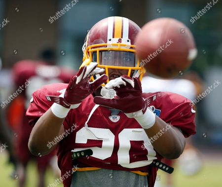 Richard Crawford Washington Redskins cornerback Richard Crawford catches the ball during a drill in practice at the team's NFL football training facility, in Richmond, Va