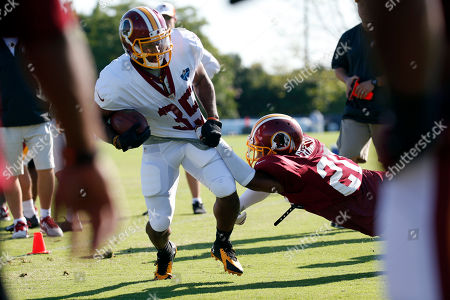 Lache Seastrunk, Richard Crawford Washington Redskins running back Lache Seastrunk is brought down by cornerback Richard Crawford during practice at the team's NFL football training facility, in Richmond, Va