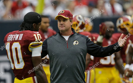 Jay Gruden Washington Redskins head coach Jay Gruden talks to quarterback Robert Griffin III before an NFL football game against the Houston Texans in Houston. Game 1 of the Jay Gruden era with the Redskins looked a lot like the final games under Mike Shanahan